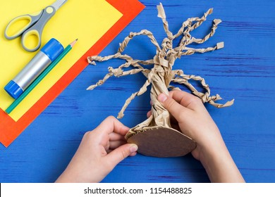 How to make together with child autumn tree from craft package. Original children's art project. DIY concept. Step-by-step photo instructions. Step 6. Stick cardboard to base of tree