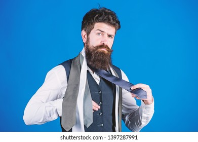 How to match necktie with shirt and suit. Man bearded hipster hold few neckties on blue background. Guy with beard choosing necktie. Gentlemens guide. How to choose right tie. Classic style.