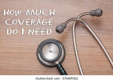 How much coverage do i need? Medical concept : stethoscope on note book with wood background