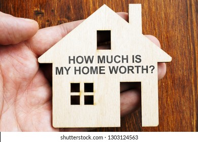 How much is my home worth? Sign on the model of house.
