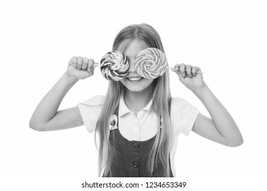 How much sugar ok. Girl cute smiling face holds sweet lollipops. Girl likes sweets as lollipops candies, isolated white background. Celebrate holidays birthdays with sweets. Kids away sugary treats.