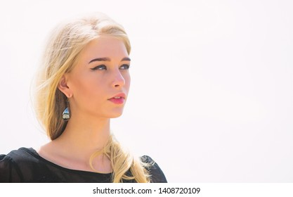 How to repair bleached hair fast and safely. Bleaching roots. Hairdresser tips concept. Salvaged my bleached hair. How to take care of bleached hair. Girl tender blonde makeup face sky background.