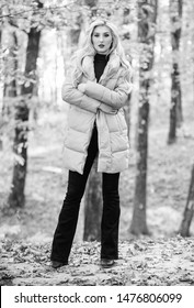 How to rock puffer jacket like star. Fall fashion concept. Outfit prove puffer coat can look stylish. Jackets everyone should have. Girl fashionable blonde walk in park. Best puffer coats to buy.