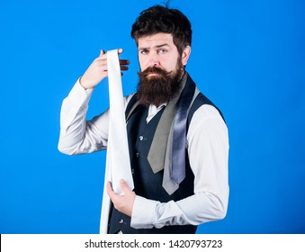 How to select tie. When dressing in suit necktie often add dash of flavor to overall outfit. Guy with beard choosing necktie. Perfect white silk necktie. Man bearded hipster hold few neckties.