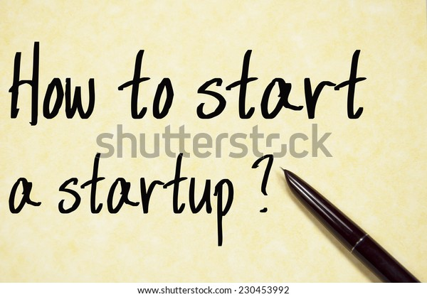 how to start a startup text write on paper