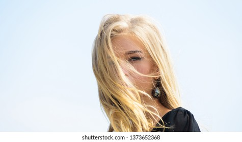 How to take care of bleached hair. Girl tender blonde makeup face sky background. Bleaching roots. How to repair bleached hair fast and safely. Hairdresser tips concept. Salvaged my bleached hair.