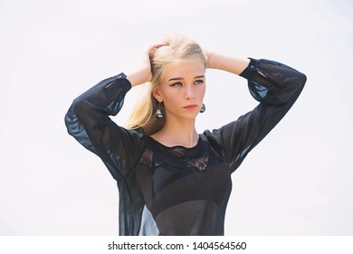 How to take care of bleached hair. Hairdresser tips concept. Salvaged my bleached hair. Girl tender blonde makeup face sky background. How to repair bleached hair fast and safely. Bleaching roots.