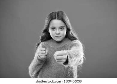 How teach kids to defend themselves. Self defense strategies kids can use against bullies. Girl hold fists ready attack or defend. Girl child cute but strong. Self defense for kids. Defend Innocence.