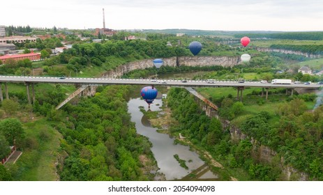 How to travel during quarantine. Hot air balloon. Colorful hot-air balloons flying over the canyon and under the bridge.