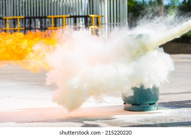 How to use a fire extinguisher with  gas container during training.