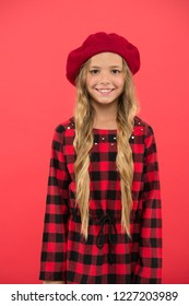 How to wear beret like fashion girl. Kid little cute girl with long hair posing in hat red background. How to wear french beret. Beret style inspiration. Fashionable beret accessory for female.