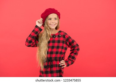 How to wear beret like fashion girl. Kid little cute girl with long hair posing in hat red background. Fashionable beret accessory for female. How to wear french beret. Beret style inspiration.