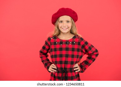 How to wear beret like fashion girl. Fashionable beret accessory for female. Kid little cute girl with long hair posing in hat red background. How to wear french beret. Beret style inspiration.