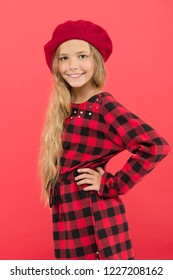 How to wear french beret. Beret style inspiration. How to wear beret like fashion girl. Fashionable beret accessory for female. Kid little cute girl with long hair posing in hat red background.