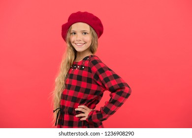 How to wear french beret. Beret style inspiration. How to wear beret like fashion girl. Kid little cute girl with long hair posing in hat red background. Fashionable beret accessory for female.