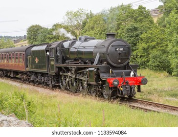 HOWARTH, ENGLAND, JUNE 23 2018 Former London Midland and Scottish Railways Class 5 Standard steam loco 45212 leaving Howarth on the Keighley and Worth Valley Railway, England.