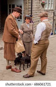 Howarth, West Yorkshire, England, UK. May 19th 2017. Participants to the Haworth 1940's weekend in wartime costumes in the decorated village. Haworth, West Yorkshire, England, UK