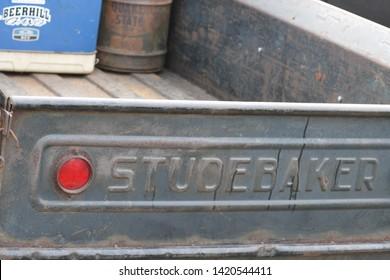 Howell, NJ / USA - June 1, 2019: Closeup of label of 1957 Studebaker Transtar truck tailgate at Classic Car Club Night