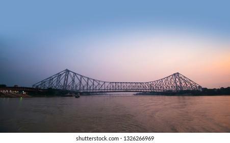 Howrah bridge - The historic cantilever bridge on the river Hooghly with twilight sky. Howrah bridge is considered as the busiest bridge in India.