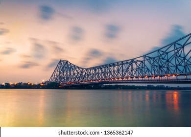 Howrah bridge - The historic cantilever bridge on the river Hooghly in West Bengal with twilight sky. Howrah bridge is considered as the busiest bridge in India.