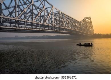 Howrah bridge - the historic cantilever bridge on the Ganges river at sunrise. Kolkata, India.