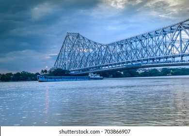 Howrah bridge - The historic cantilever bridge on the river Hooghly with moody sky.