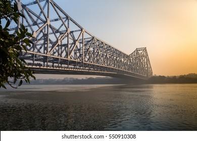Howrah bridge on river Ganges on a foggy winter morning. Kolkata, India.