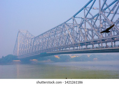 Howrah Bridge on river Hooghly at sunset. Howrah Bridge is a cantilever bridge with a suspended span over the Hooghly River in kolkata city, West Bengal, India
