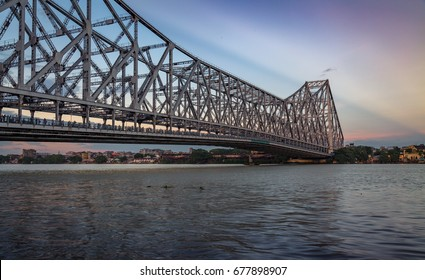 Howrah bridge on river Hooghly at dusk. A historic bridge which connects the city of Kolkata with the Howrah district.