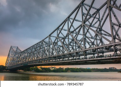 Howrah bridge on the river Hooghly during sunset in Kolkata, India