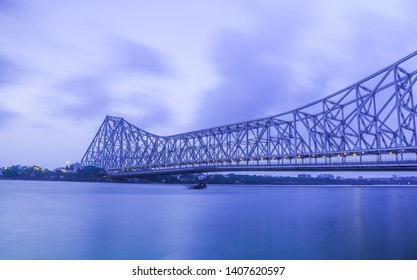 Howrah bridge at the time of cyclone Fani in kolkata . This is a historic cantilever bridge on the river Hooghly ( Ganges) with cloudy sky. Howrah bridge is considered as the busiest bridge in India.