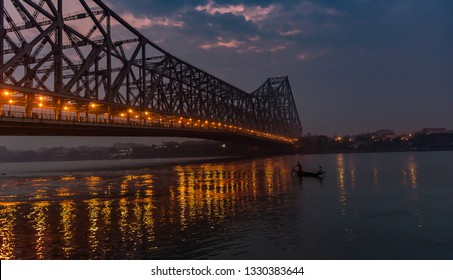 Howrah Bridge at the time of Sunrise.  Howrah Bridge is a bridge with a suspended span over the Hooghly River in West Bengal, India.