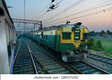 HOWRAH STATION , HOWRAH, WEST BENGAL / INDIA - 4TH FEBRUARY 2018 : A passenger train passing through railway track in late afternoon.
