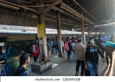 HOWRAH STATION , HOWRAH, WEST BENGAL / INDIA - 4TH FEBRUARY 2018 : Passengers at railway platform of Howrah station .