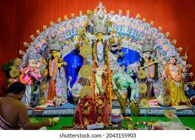 Howrah, West Bengal, India - 24th October 2020 : Goddess Durga is being worshipped by Hindu priest. Puja in Coronavirus pandemic.