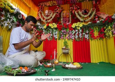 Howrah, West Bengal, India - 7th July 2019 : Hindu priest worshipping idol of God Jagannath, Balaram and Suvodra. Ratha jatra festival is famous Hindu festival in India.