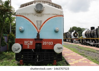 "Howrah, West Bengal/India - July 9, 2019: Blue White Vintage 'Narrow Gauge Steam Locomotive' display for public with nature around, at ""Rail Museum"" Howrah, West Bengal 711101."
