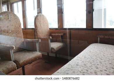 "Howrah, West Bengal/India - July 9, 2019:  Old Vintage Sitting arrangements or seats inside railway coach display of a vintage locomotive for public, at ""Rail Museum"" Howrah, West Bengal 711101."