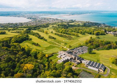 Howth, co. Dublin, Ireland - May 2021 : Aerial view of Howth Peninsula with  Deer Park Golf course in the frame. Sutton and Baldoyle visible at the far distance.