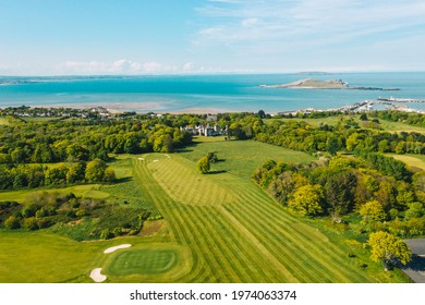Howth, co. Dublin, Ireland - May 2021 : Aerial view of Howth Peninsula with  Deer Park Golf course in the frame.