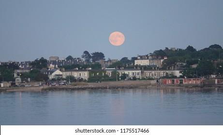 Howth, County Dublin, Ireland, rising moon over the Howth city