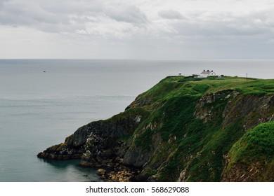 Howth, Dublin, Ireland - June 2016 - Baily Lighthouse on the cliff edge.