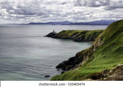 HOWTH Dublin, July 25, 2015 View of the Baily Lighthouse from the cliff in a cloudy day in Howth, Ireland July 25, 2015