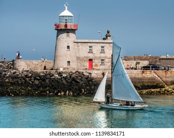 HOWTH .DUBLIN.IRELAND-June 09, 2018 : Lighthouse and sailing boats in Howth harbor