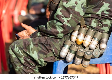 Hpa An, Myanmar - January 06, 2019 : Unidentified Karen military belting  explosives the M79  around the waist at the headquarter in the forest border near Thailand.