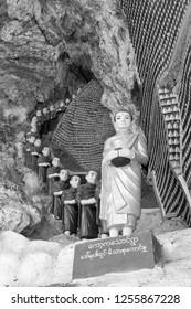 HPA-AN, MYANMAR - 19 NOVEMBER, 2018: Black and white picture of aligned monks statues at Kaw Ka Thaung Cave, located close to Hpa-An, Myanmar