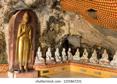HPA-AN, MYANMAR - 19 NOVEMBER, 2018: Horizontal picture of different Buddhas statues inside of Kaw Ka Thaung Cave, located close to Hpa-An, Myanmar