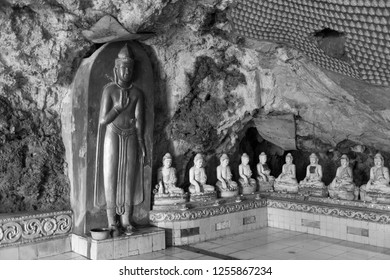 HPA-AN, MYANMAR - 19 NOVEMBER, 2018: Black and white picture of different Buddhas statues inside of Kaw Ka Thaung Cave, located close to Hpa-An, Myanmar
