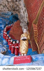 HPA-AN, MYANMAR - 19 NOVEMBER, 2018: Vertical picture of aligned monks statues at Kaw Ka Thaung Cave, located close to Hpa-An, Myanmar