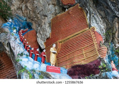 HPA-AN, MYANMAR - 19 NOVEMBER, 2018: Horizontal picture of aligned monks statues at Kaw Ka Thaung Cave, located close to Hpa-An, Myanmar